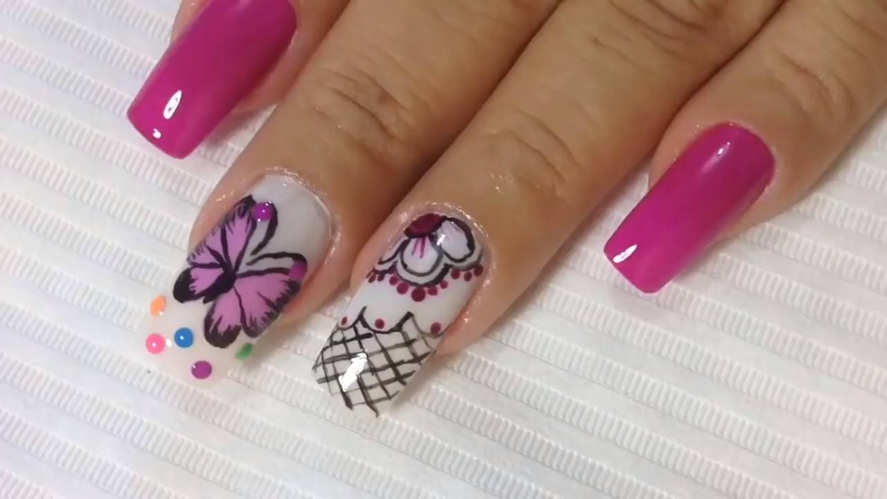 Tutorial de decoração de unha com desenho de borboleta desenhado a mão