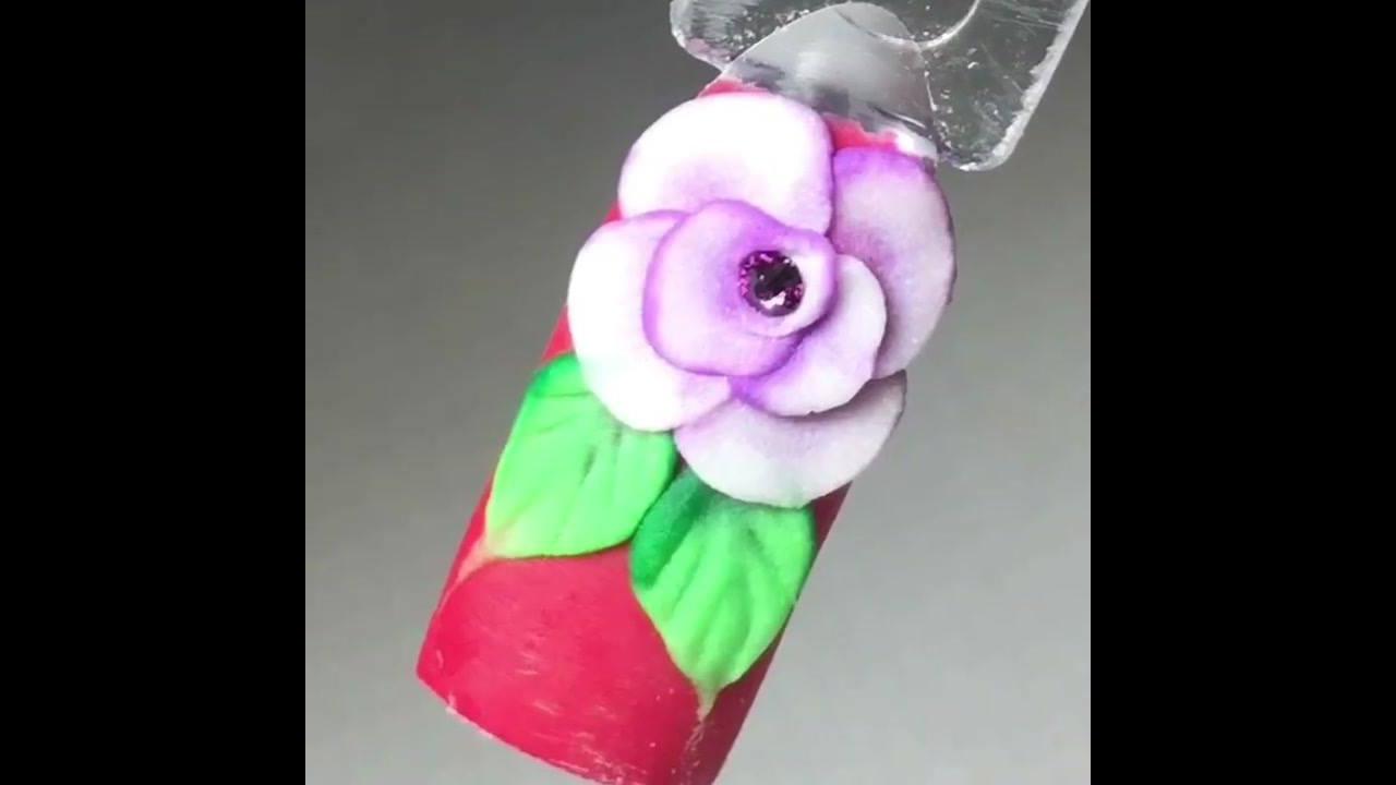 Unhas decoradas com flor em 3D