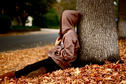 Girl-hoody-sitting-autumn-fall-park_large