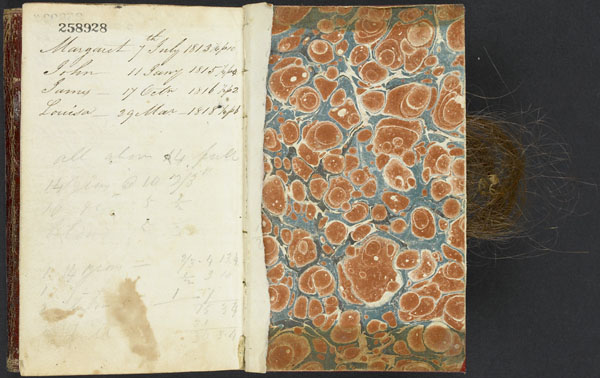 By Hugh Macdonald, 1820. View of writing and human hair on the left side and marble endpaper on the right side of the journal. Library and Archives Canada, e008295645.