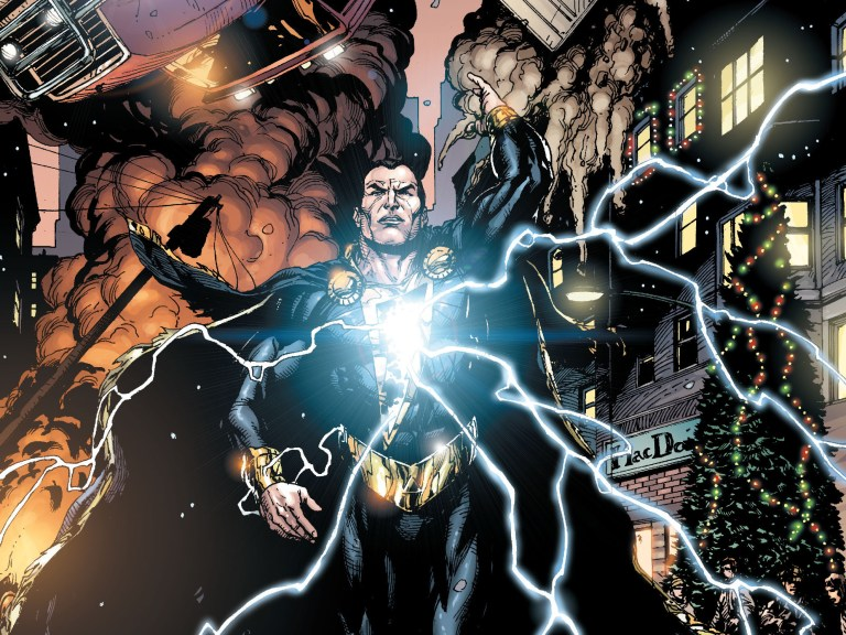 Black Adam with lightning energy crackling from his chest outward lifting cars and destroying property.
