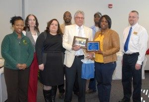 Students and faculty members from the VGCC chapter of Phi Beta Lambda honored Bobby Van Brunt during his retirement reception; in front, from left: student Ruthie Davis, chapter president Theresa Chiplis, Bobby Van Brunt, chapter adviser LaTonya Steele and co-adviser Carl Hann; in back, from left: chapter vice president Diane Power, co-adviser Delton Farmer and VGCC graduate/professional division member Lonnie Brame. (VGCC photo)