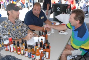 From left, VGCC Culinary Arts student Randy Wilfong of Henderson, program head Chef Ross Ragonese and student Tom Schmuker of Creedmoor taste sauces and compare notes while serving as judges at the seventh annual North Carolina Hot Sauce Contest in Oxford on Sept. 14, 2013