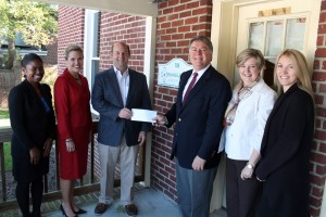 The Boys & Girls Clubs received $8,000 from Triangle North Healthcare Foundation's Chairman Eddie Ferguson and Executive Director Val Short during a presentation on Tuesday from the proceeds of the Foundation's 2nd Annual Golf Tournament held last month.  Attending the presentation were, from left,  April Scott, Boys & Girls Clubs Acting Director, Tanya Evans and Paul Harris, from the Boys & Girls Clubs Board of Directors, Ferguson, Short, and Jeannie Adcock, from Maria Parham Medical Center.