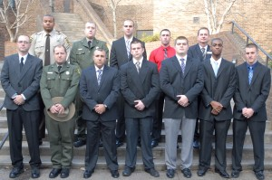 On front row, from left, VGCC Basic Law Enforcement Training Class 97 graduates Phillip Joel Trivette, James Thomas Rusher, David Warren Jacobs, Cody Marshall Tuck, Ryne Ty Shellman, Tevin Demetri Dixon and Zachary Edwin Lambert; on back row, from left, Keishawn Lamar Mayes, Andrew James Boos, Cody Jacob Goldsmith and Devin Shaun Whitlow with VGCC law enforcement training coordinator Tony Pendergrass. (VGCC Photo)