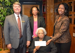 Geraldine Green Gooch (seated) and Katrina Gooch Lawson (standing, center) present contributions to the VGCC Endowment Fund, represented by Endowment Director Eddie Ferguson (left) and VGCC President Dr. Stelfanie Williams (right). (VGCC photo)