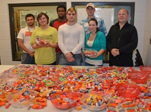 VGCC Criminal Justice Club members packed bags of Halloween candy for area senior citizens. Students included, from left, on front row, Benjamin Layton of Kittrell, Joseph Toto of Oxford, Yancey Otero of Oxford and Paul Grenier of Oxford; from left, on back row, William Douglas of Henderson, Kendrick Gregory of Henderson and William Nutt of Henderson. (VGCC photo)
