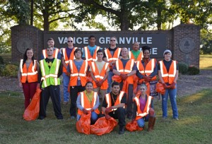 VGCC Criminal Justice Club members take a break during their clean-up along Poplar Creek Road in front of the college's Main Campus. Kneeling in front, from left, are Janet Rodriguez Morales of Henderson, William Douglas of Henderson and Stacie Bowes of Henderson; standing in middle row, from left, are Jordan Dickerson of Oxford, Joseph Toto of Oxford, Benjamin Layton of Kittrell, Marshall Keeton of Butner, Paul Grenier of Oxford, Jasmine Allen of Warrenton and Karly Blue of Stem; standing in back, from left, are Nicolas Parkstone of Stem, William Nutt of Henderson, Isaiah Blanchett of Monroe, James Hann of Creedmoor and instructor/club advisor Tony Clark. (VGCC photo)