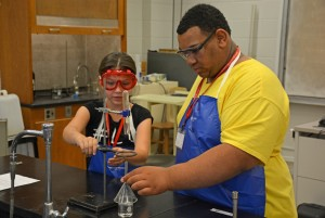 From left, Science Camp participants Savannah Jones of Creedmoor and Mar'kevious Cheatham of Oxford set up a chemistry experiment. (VGCC photo)