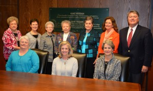 Representatives of Dr. Mills's family, the Guild and VGCC gathered in the board room on the college's Main Campus to mark the creation of the new scholarship. Seated, from left, are Kathy Mills Williams, Janet Mills and Jane Mills Hicks, all of Henderson. Standing, from left, are Guild Gift Gallery volunteers Gean Bobbitt, Roxanne Fleming, Lou Reavis, Sylvia Edwards and Guild president Anne Bunch, all of Henderson, VGCC Endowment Specialist Kay Currin and Endowment Director Eddie Ferguson. (VGCC photo)
