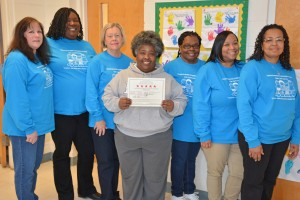 The staff of the VGCC Child Care Center, including, from left, Rhonda Pegram, Bridget Perry, Kathy Hughes, Deborah Harris, Lizzie Nelms, Pam Harris and Hilda Cordell, proudly display the certificate indicating the center's renewed five-star license. (VGCC Photo)
