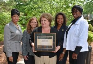 """Shown from left with the plaque awarded by NCMPR to VGCC for the """"Vanguard Voyager"""" are Dr. Angela Ballentine, VGCC vice president of academic and student affairs; Cynthia Young, dean of arts and sciences; Beth Gray, publications coordinator for the VGCC Communications department; Angela Gardner-Ragland, dean of business and applied technologies; and Angela Thomas, dean of health sciences. Gray designed the Voyager from data submitted by VGCC faculty and staff coordinated by the college's deans under the leadership of Dr. Ballentine. Not pictured: Dale Fey, VGCC dean of continuing education. (VGCC photo)"""