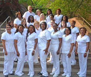 Graduates honored at the VGCC Practical Nursing pinning ceremony included, first (front) row, from left: Sarala Neupane, Rita Udjoh, Adeola Sonaiya, Nzinga Taliaferro, Maena Simmons, Jeanne Tropnas and Winrose Githiiyi; second row, from left: Kaneshea Thomas, Jessica Rooks, Lisa Perry, Amber McKee, Jennifer Crowder, and Branice Chogo; third row, from left: Andrea' Thompson, Dorcas Smith, Emilee Carlson, Jane Gathogo and Annah Ongeri; fourth row, from left: William Autrey, Heather Tunstall, Latonya Morton and Lilian Schleifer. (VGCC photo)