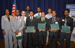 From left, in front, are VGCC President Dr. Stelfanie Williams with Male Mentoring PRIDE Award recipient Christopher Blue, Mentoring program parliamentarian Matthew Jaurique, PRIDE Award recipients Moises Ortiz, Bradley Gooch, Christopher Ford and Dajuan Harrison; in back, from left, PRIDE Award recipients Jordan Bunting, Benjamin Marshall and Sean Griffith. (VGCC photo)