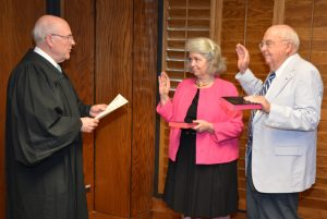 """Resident Superior Court Judge Henry W. """"Chip"""" Hight, Jr., left, administers the oath of office to Trustees Sara C. Wester, center, and Donald C. Seifert, Sr., for new four-year terms on the board. Wester is appointed by the Vance County Board of Commissioners and Seifert by the Vance County Board of Education. (VGCC photo)"""