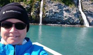 photo of Meg Blome in a boat in an Alaskan fjord