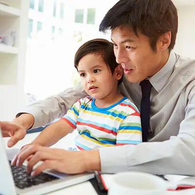 DCAP benefits; man and son typing on computer