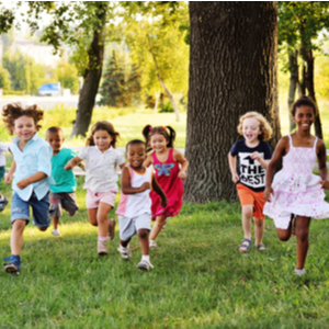 Summer Camp and Your Dependent Care FSA   (Group of children ages 3-10 years old running in a green field)