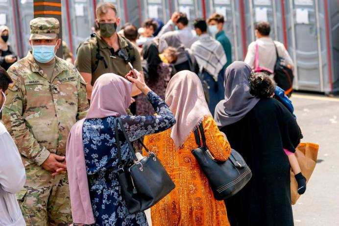 Afghan-Evacuees-Getting-Shots-At-The-Mass-Vaccine-Site-In-The-US-As-Some-Delta-Hotspots-Peak-Others-Emerge2-1