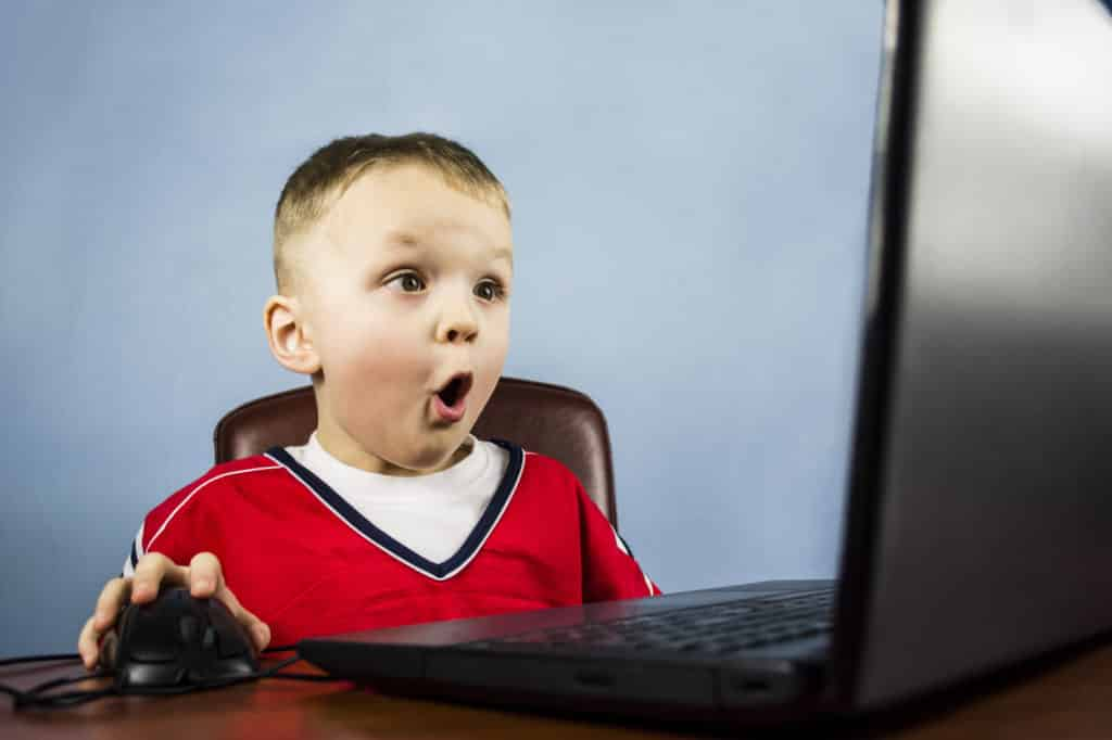 terrified child plays computer