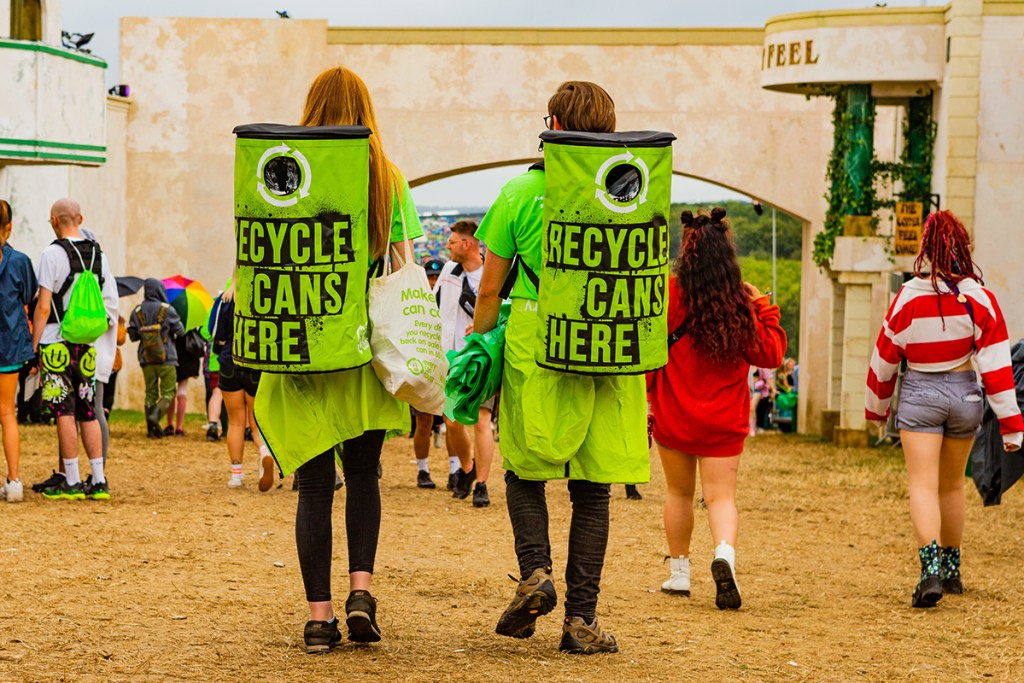 Green initiative, people walking around with recycle can here