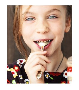 Young Girl With Spoon in Mouth