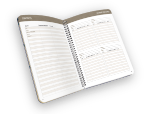 Open faced spiral-bound planner with contacts and grade sheet.