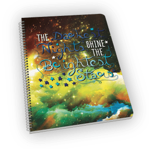 Spiral-bound notebook with stars and quote.