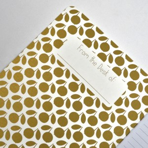 Close up of notebook with peach pattern.