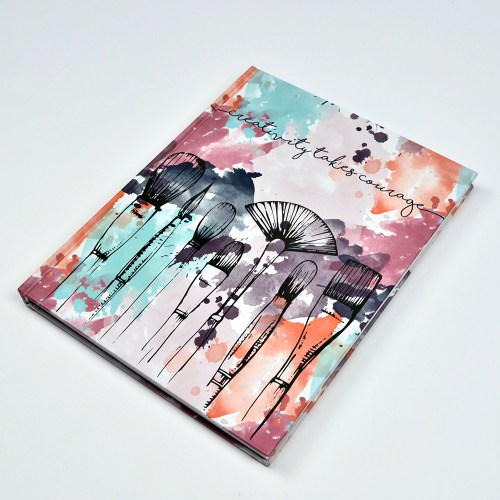 Sketchbook with a water color and paintbrush cover.