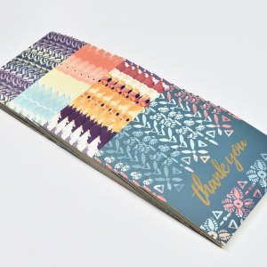 Set of designed thank you cards fanned out in a row.