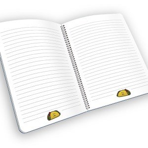 Open spiral-bound notebook with lined pages and a taco cartoon.