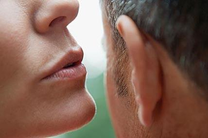 Woman Talking In Man Ear