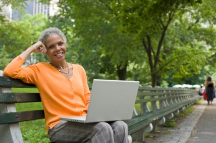 woman on laptop looking to meet single men over 40