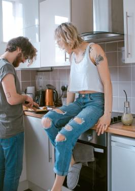 A couple, making a meal at home