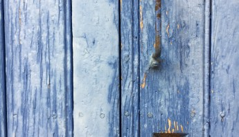 Old and pinturesque doorware detail in mediterranean French town. Wood texture