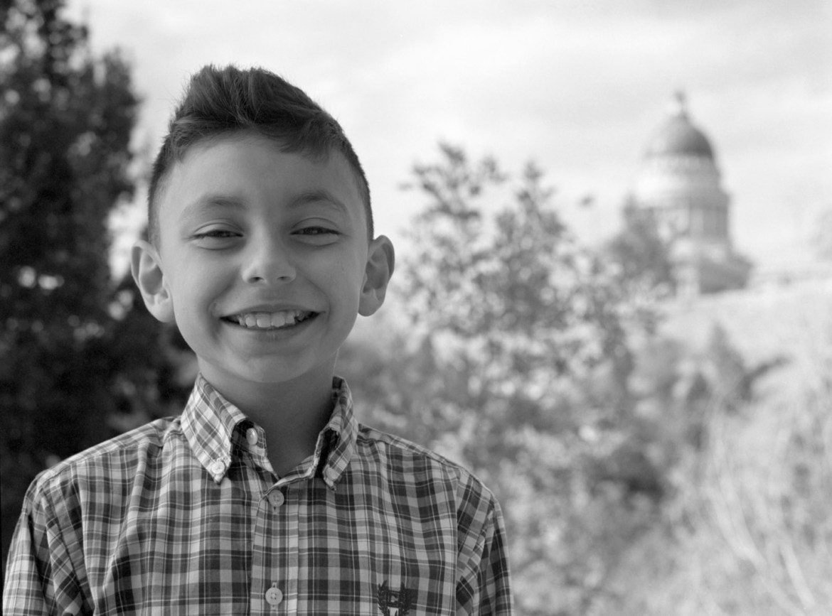 Black and white portrait with the capitol in the background