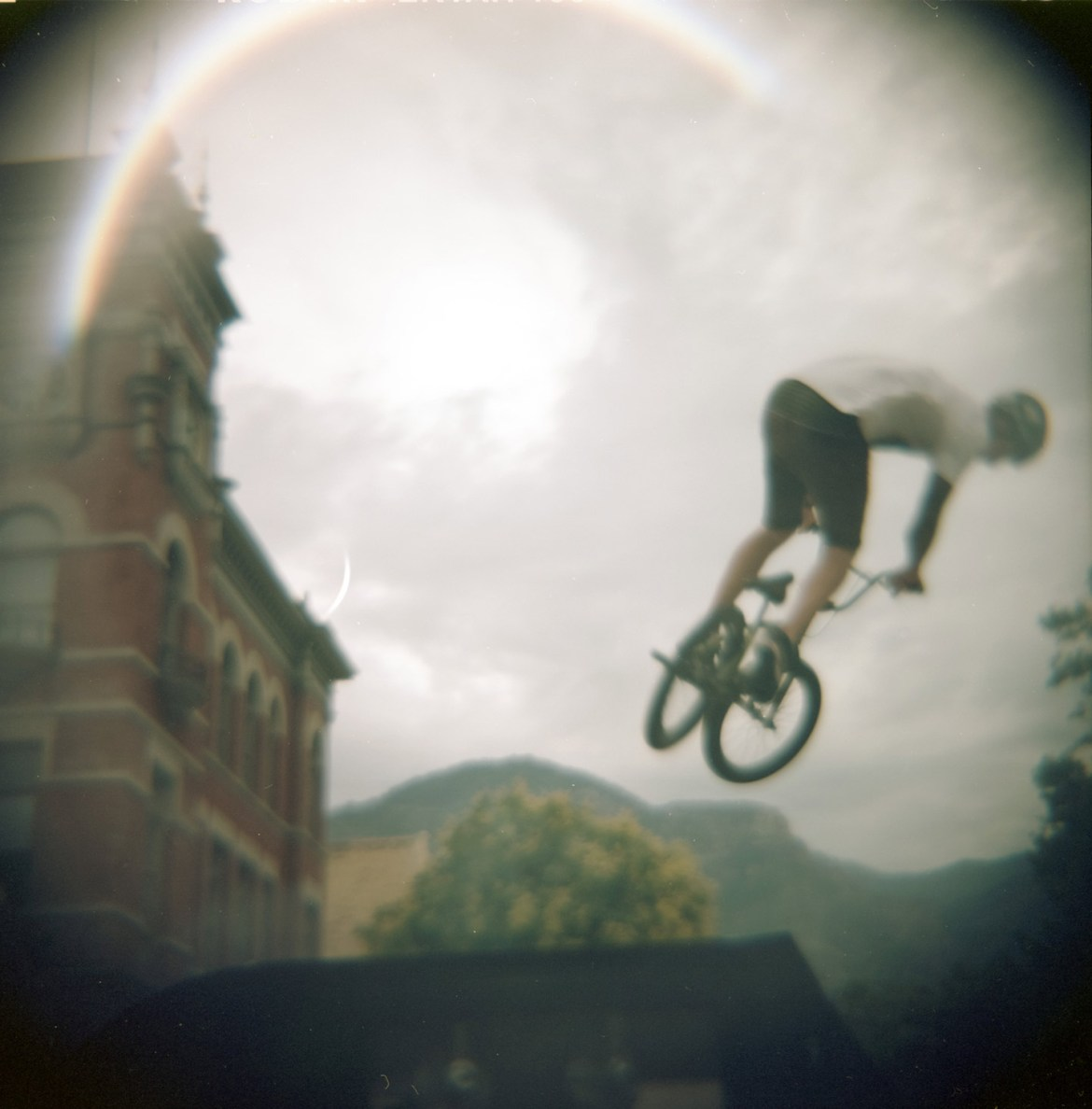 A cyclist performs some BMX stunts in the parade