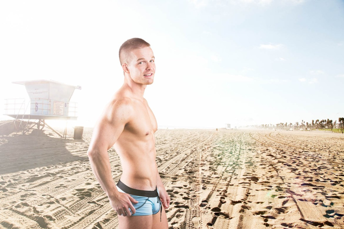 David models a swimsuit on the beach
