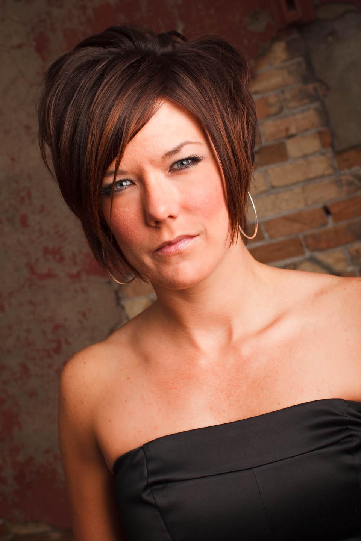 Kristin headshot against a brickwall