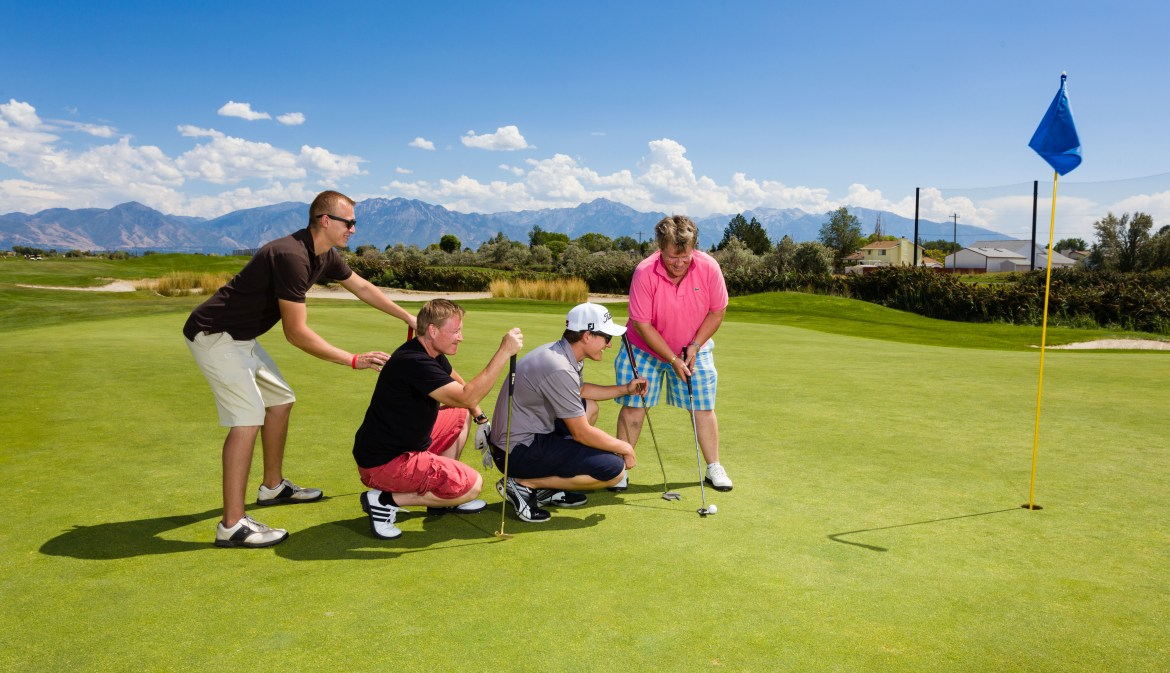 Creative golf team photos with Wasatch Mountains in the background
