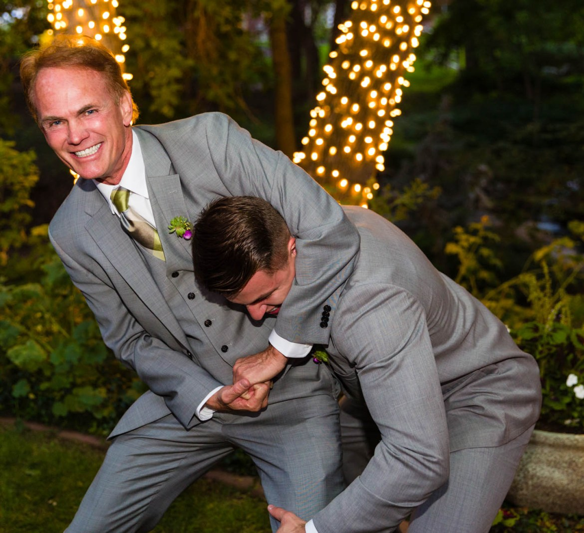 Bride's father puts the groom in a headlock