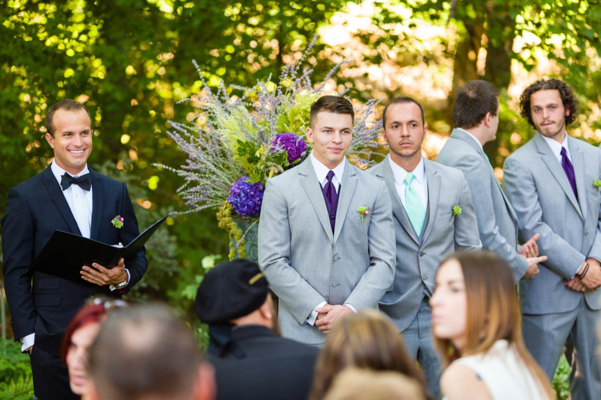 Groom watches the bride walk down the aisle