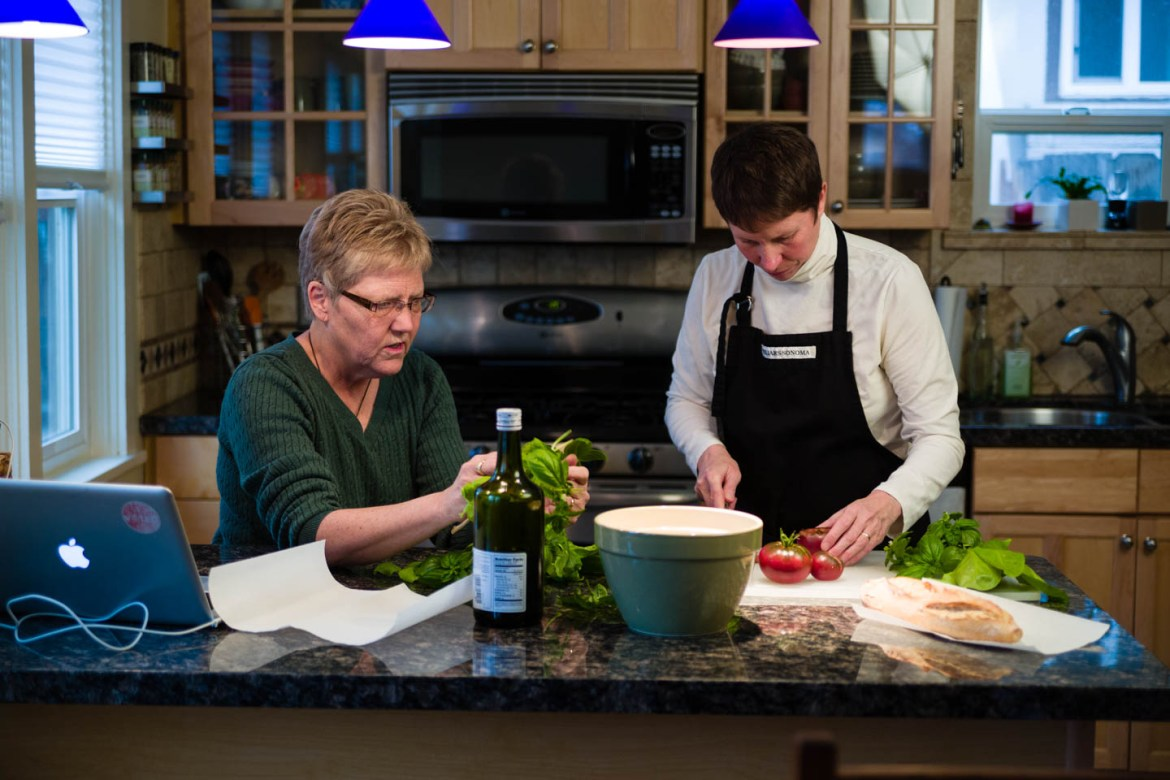 Kody Partridge and Laurie Wood prepare veggies from their greenhouse