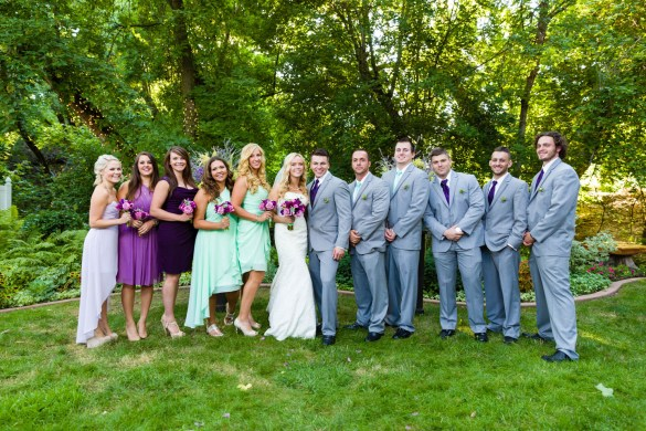 The wedding party with bride, groom, bridesmaids, and groomsmen
