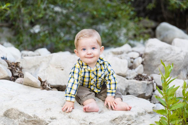 Levi sitting on rocks