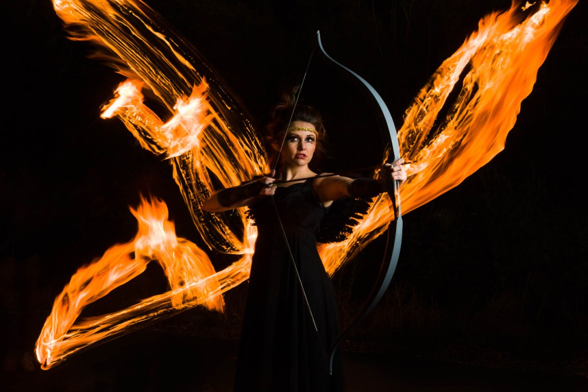 Inspired by the Hunger Games we have a model with a bow and arrow and some fire