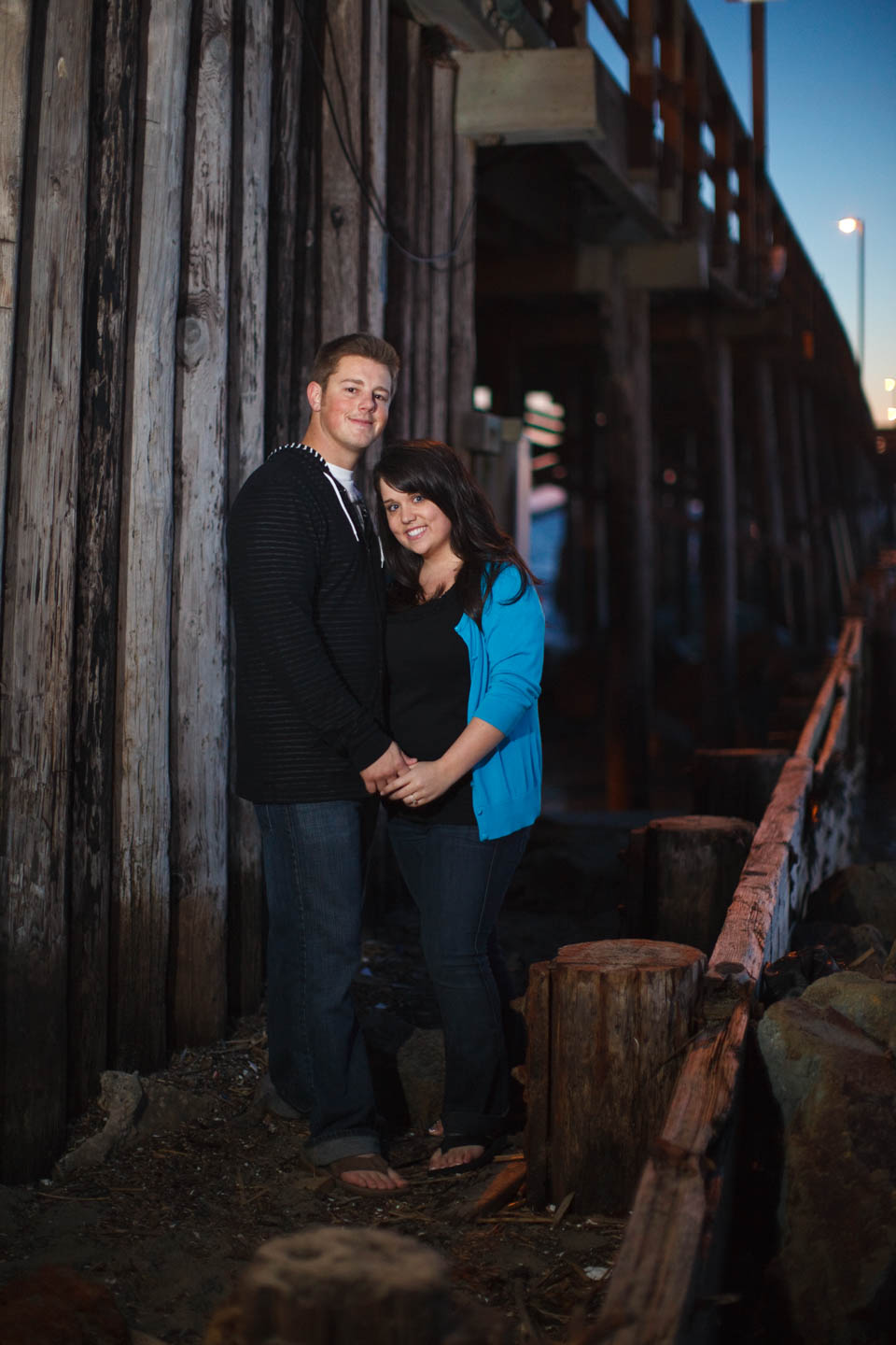 Engagement photo shoot by the pier in Newport Beach