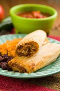 Pork tamales with black beans and rice