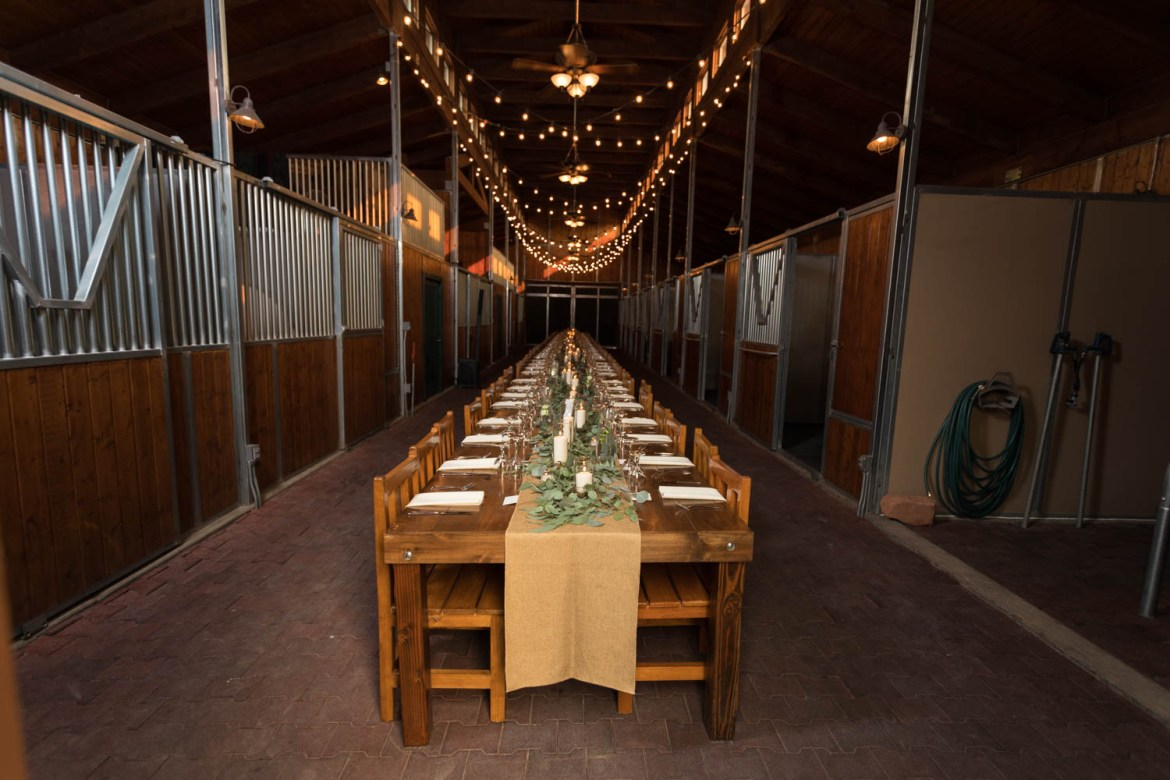 The famous long table in the barn at Red Cliff Ranch